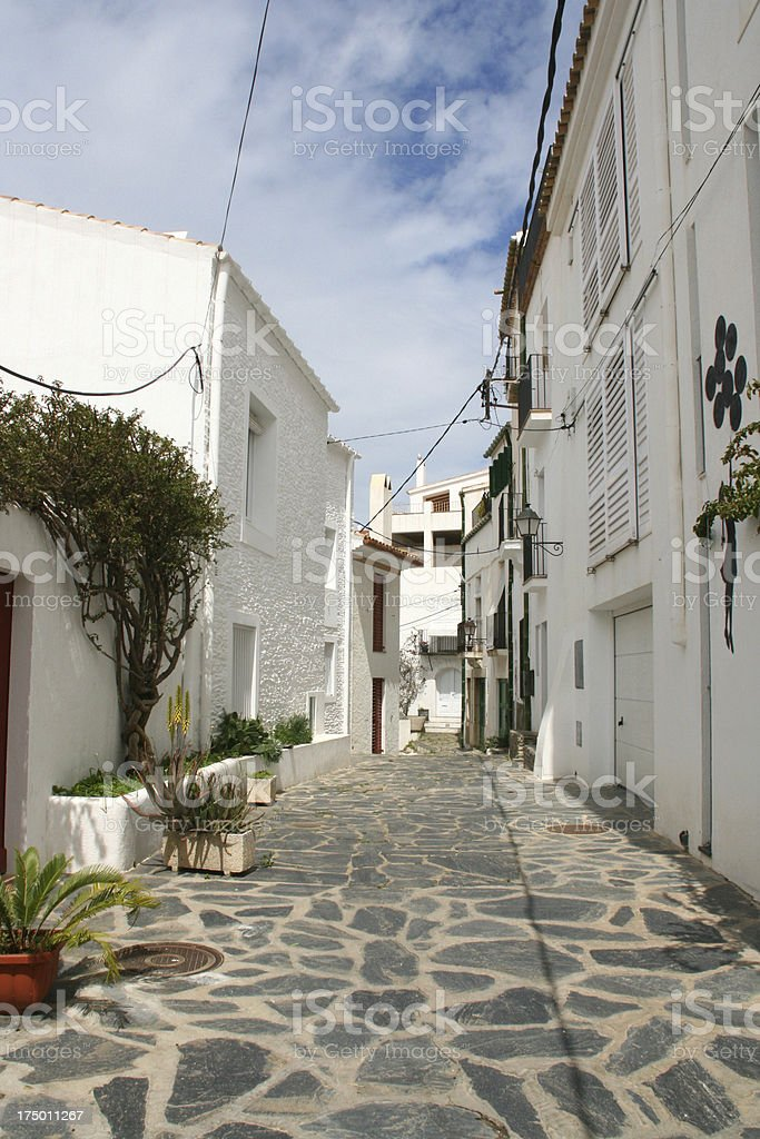Narrow white street of cadaques, cataluna, costa brava, spain royalty-free stock photo