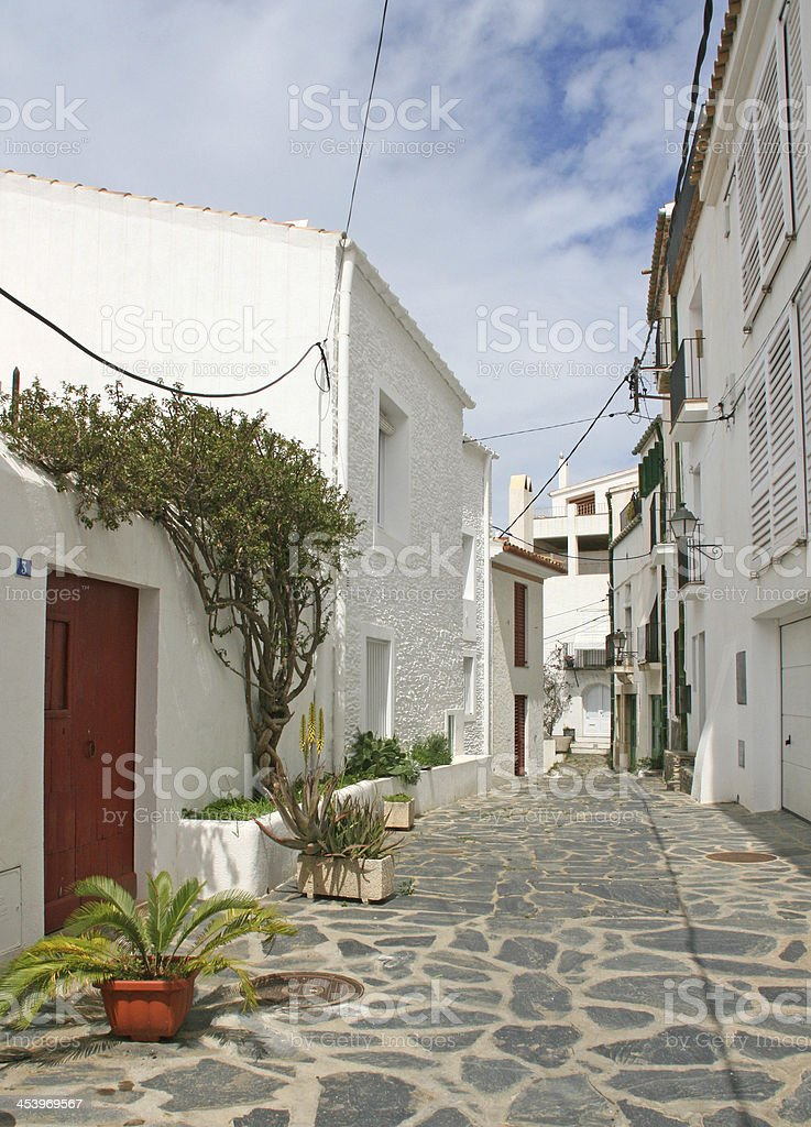 Narrow white street of cadaques, cataluna, costa brava, spain royalty-free stock photo
