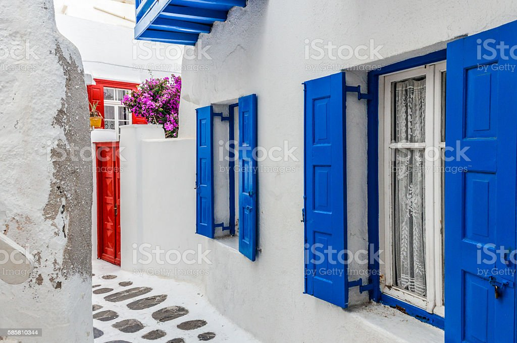 Narrow winding streets with whitewashed buildings and blue - Mykonos stock photo