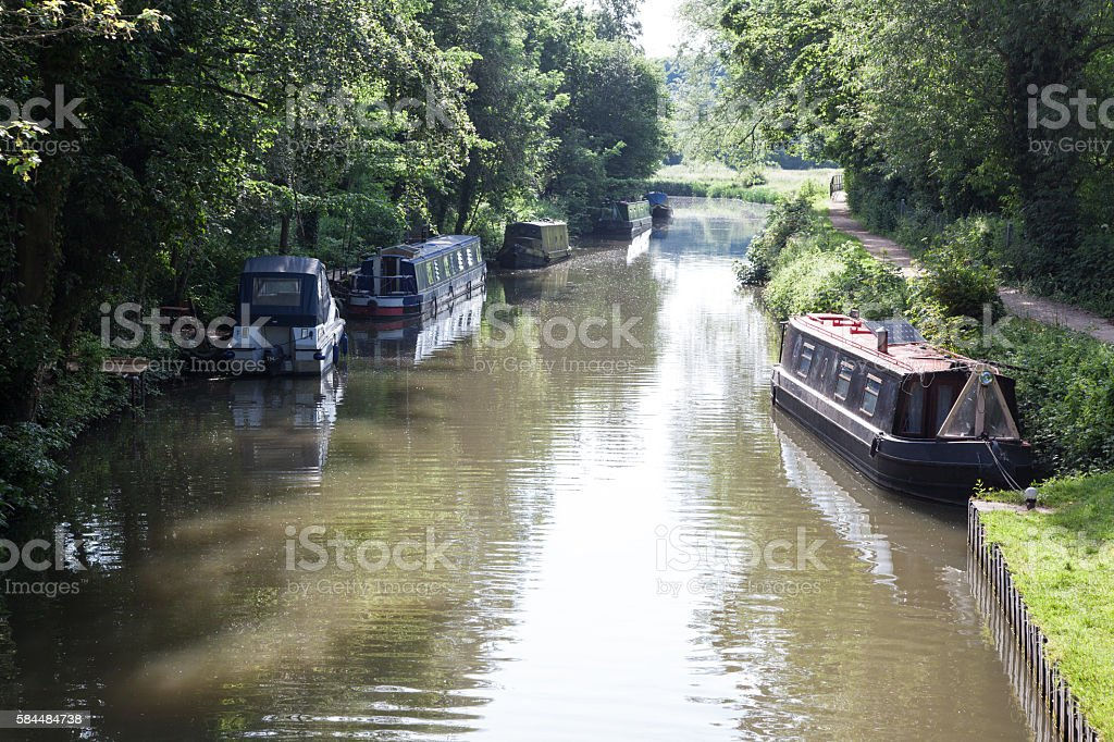 narrowboats and towpath on River Stort Hrlow Essex England stock photo