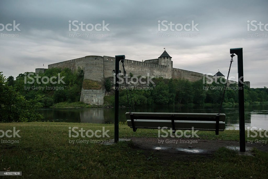 Narva River at dusk separating Russia and Estonia stock photo