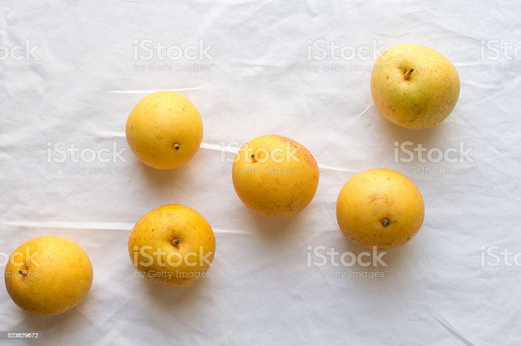 Nashi pears on tablecloth stock photo