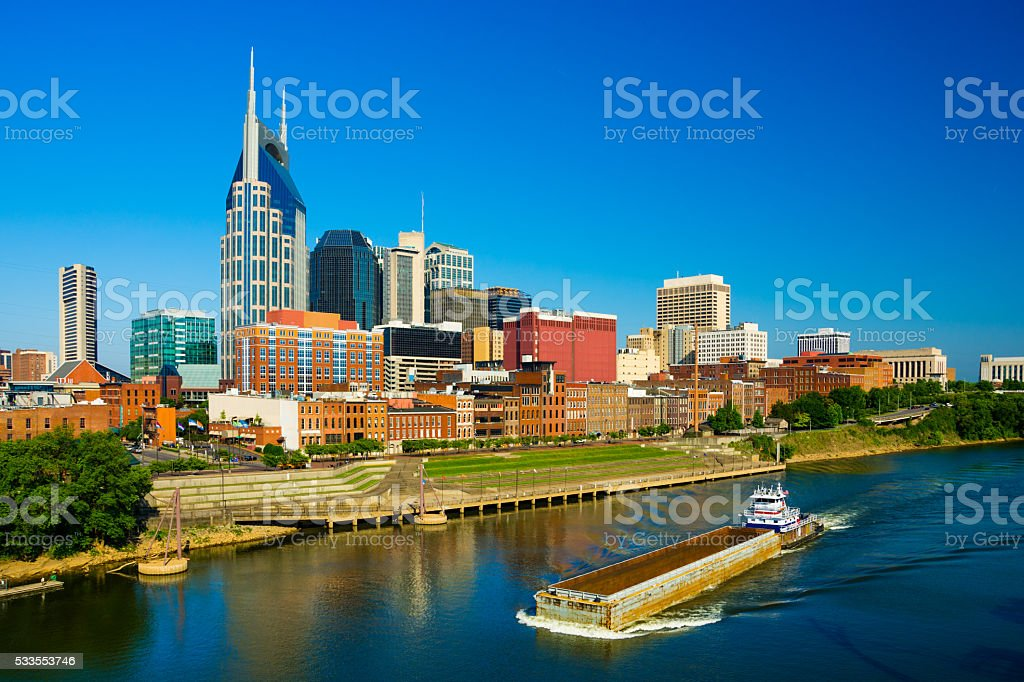 Nashville skyline, river, and barge ship stock photo
