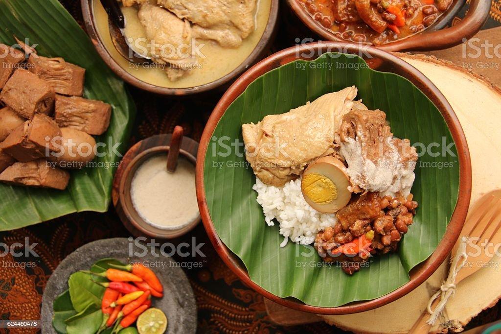 Nasi Gudeg Jogja Surrounded with the Individual Dishes stock photo