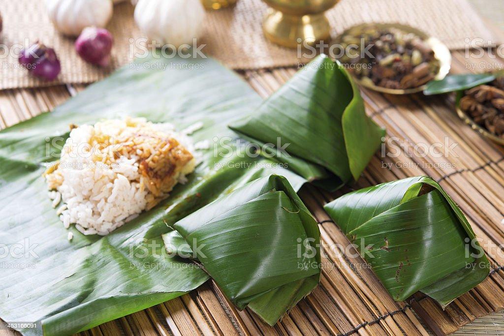 Nasi lemak wrapped with banana leaf. stock photo