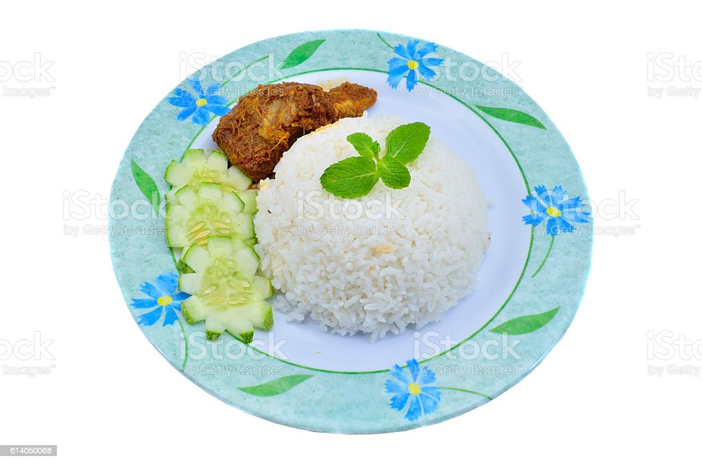 Nasi leTtraditional malaysian spicy rice dish. Served with chicken rendang stock photo