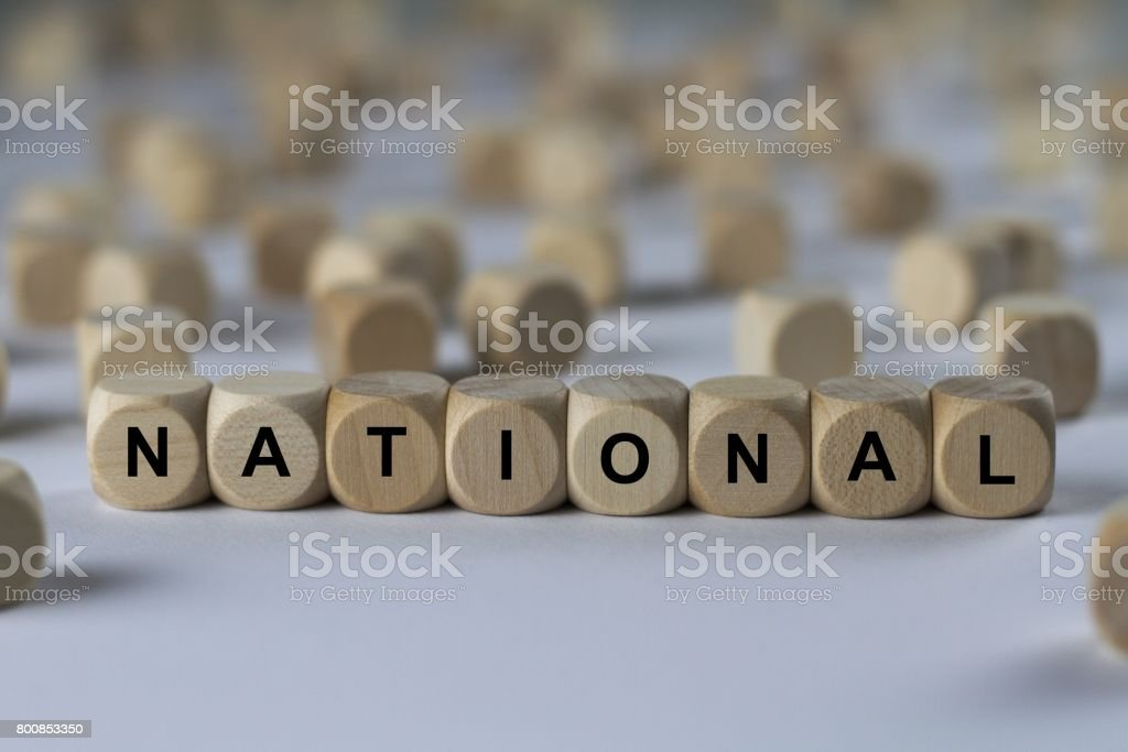 national - cube with letters, sign with wooden cubes stock photo