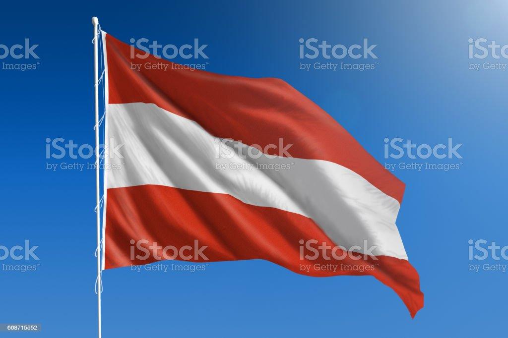 National flag of Austria on clear blue sky stock photo