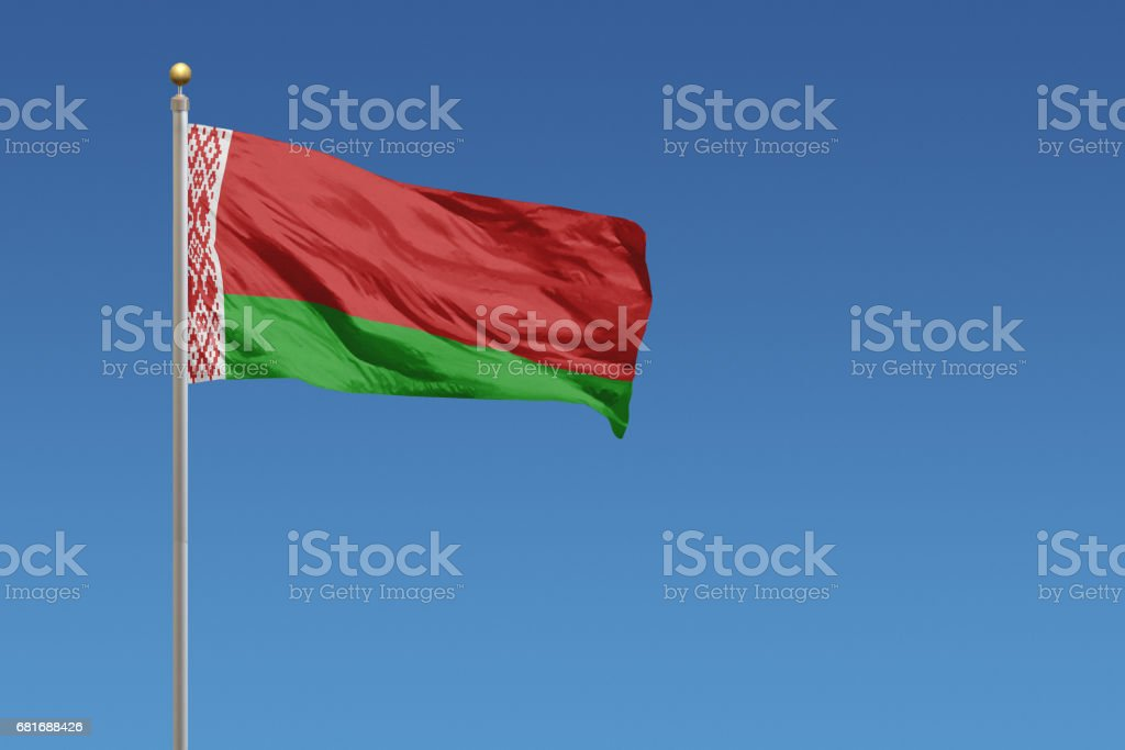 National flag of Belarus on a clear blue sky stock photo
