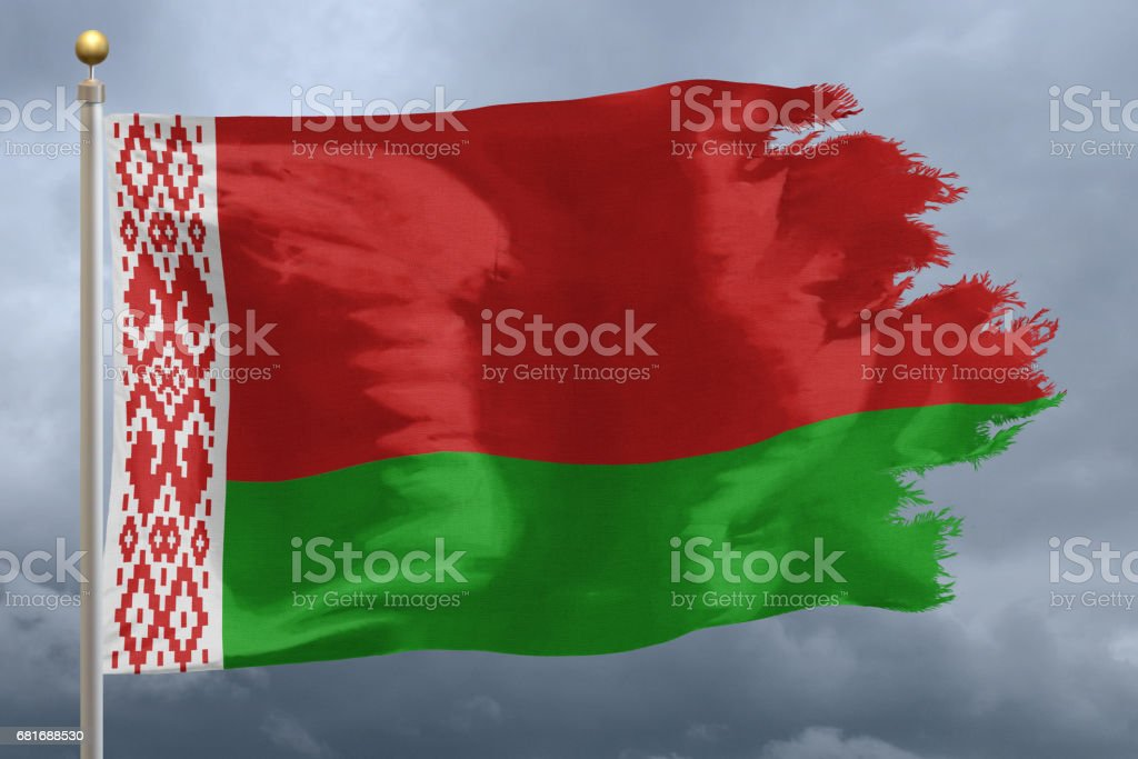 National flag of Belarus torn with storm clouds stock photo