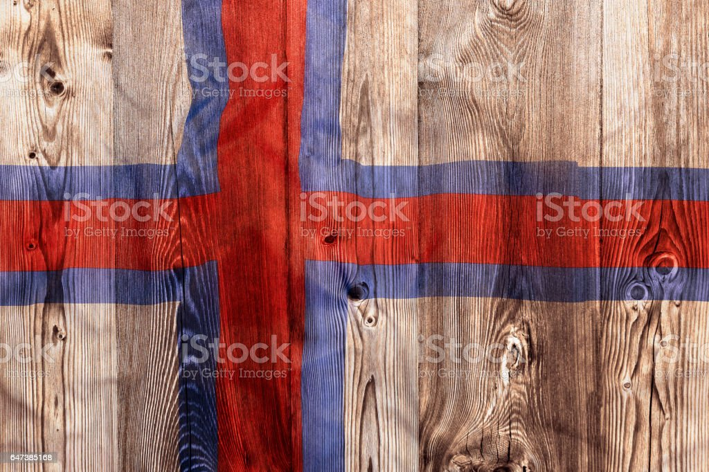 National flag of Faroe Islands, wooden background stock photo