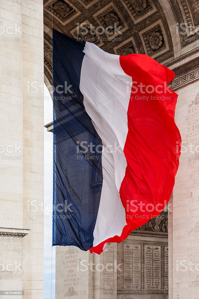 National flag of France with detail of triumphal arch, Paris, France stock photo