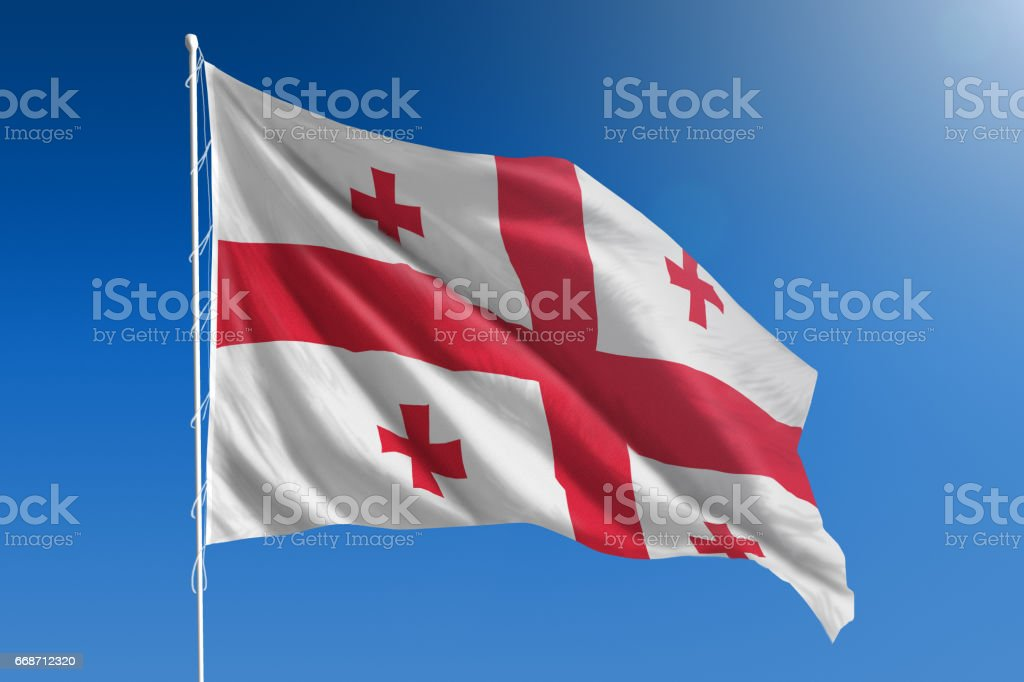 National flag of Georgia on clear blue sky stock photo