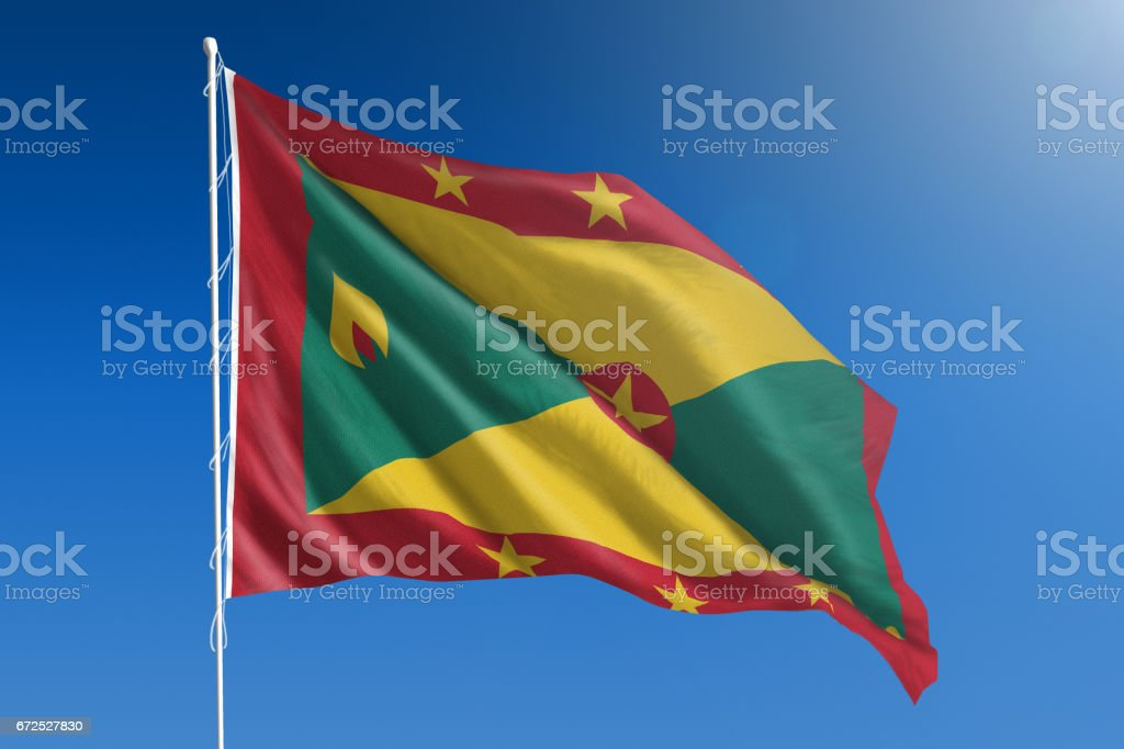National flag of Grenada on clear blue sky stock photo