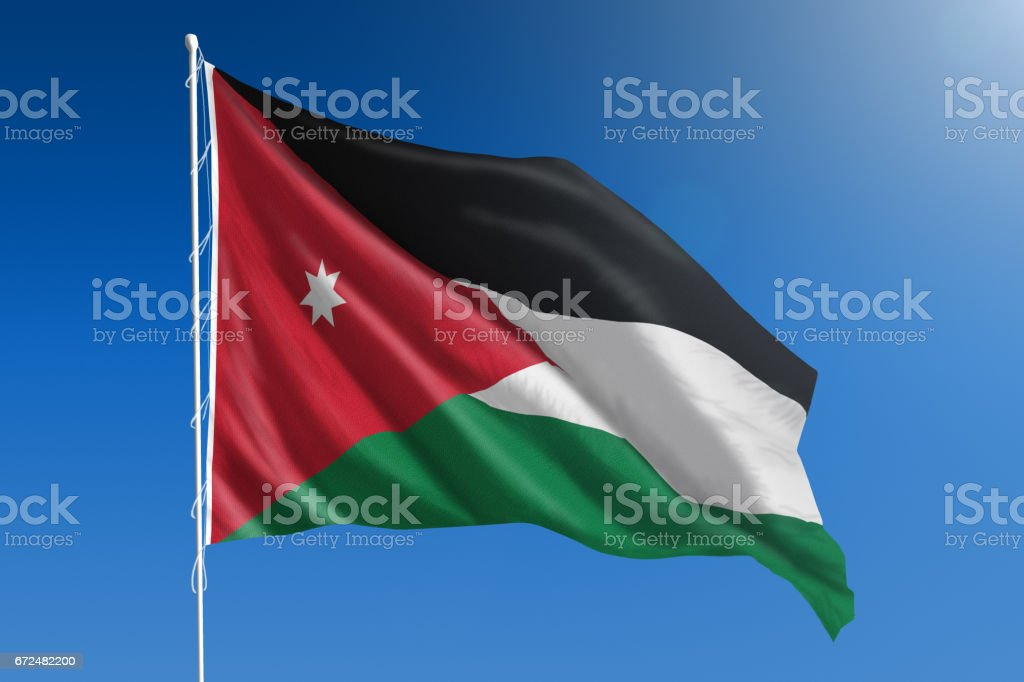 National flag of Jordan on clear blue sky stock photo