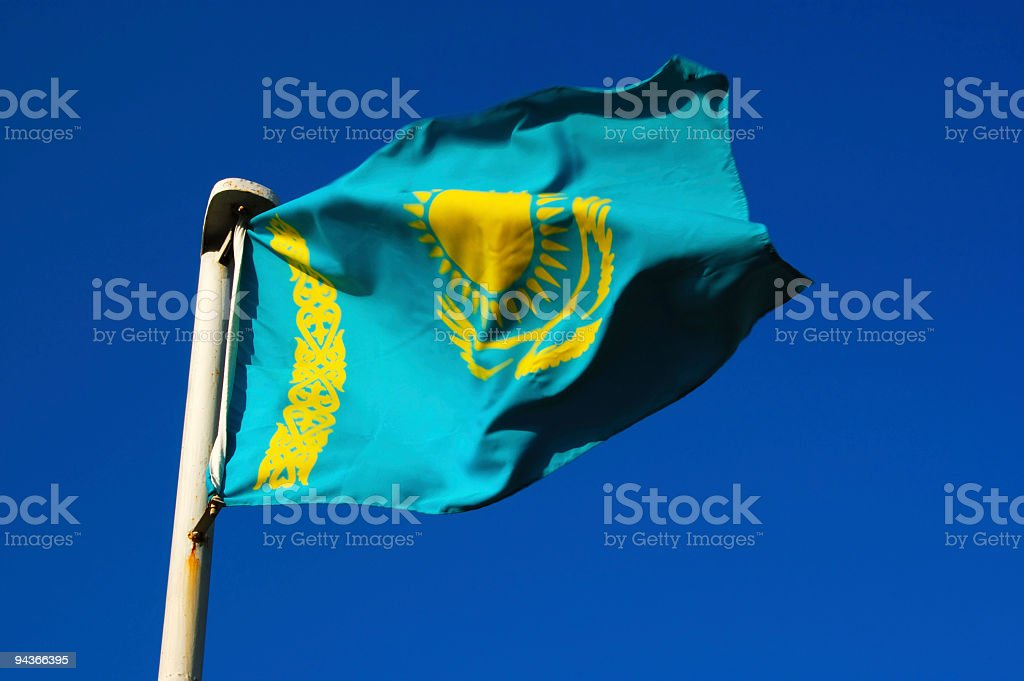 National Flag of Kazakhstan on Blue Sky royalty-free stock photo