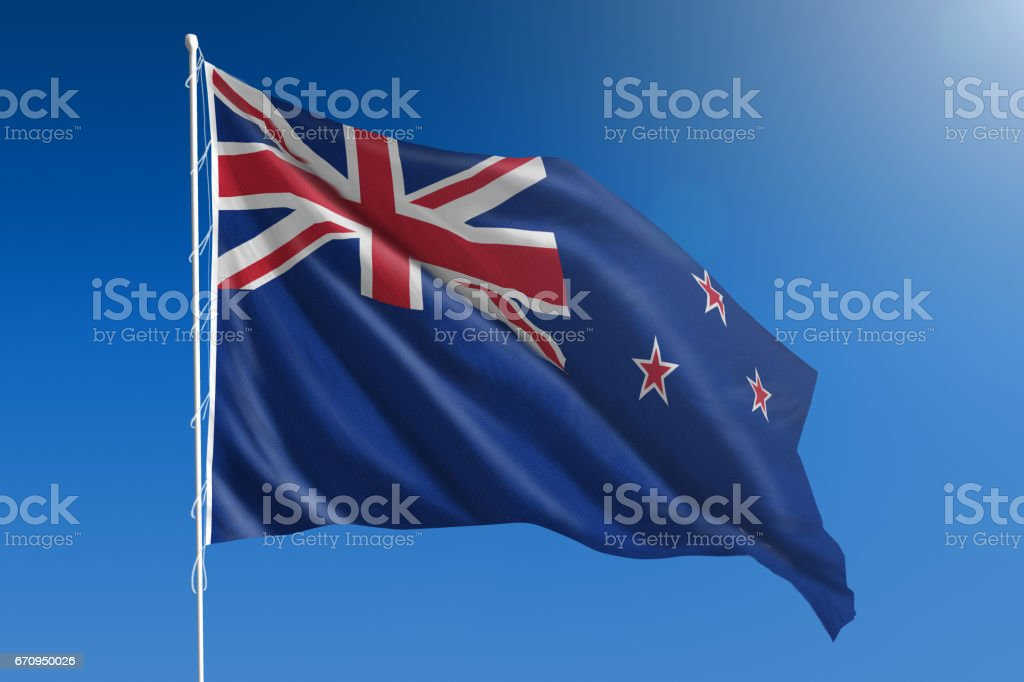 National flag of New Zealand on clear blue sky stock photo
