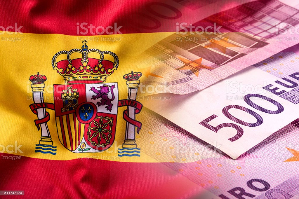 National flag of spain and euro banknote - concept. stock photo