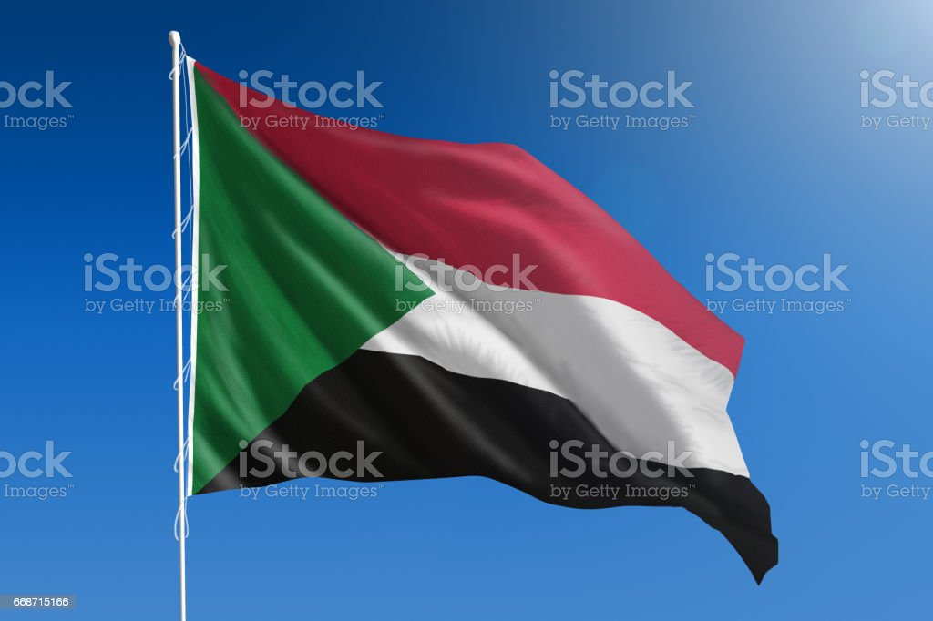 National flag of Sudan on clear blue sky stock photo