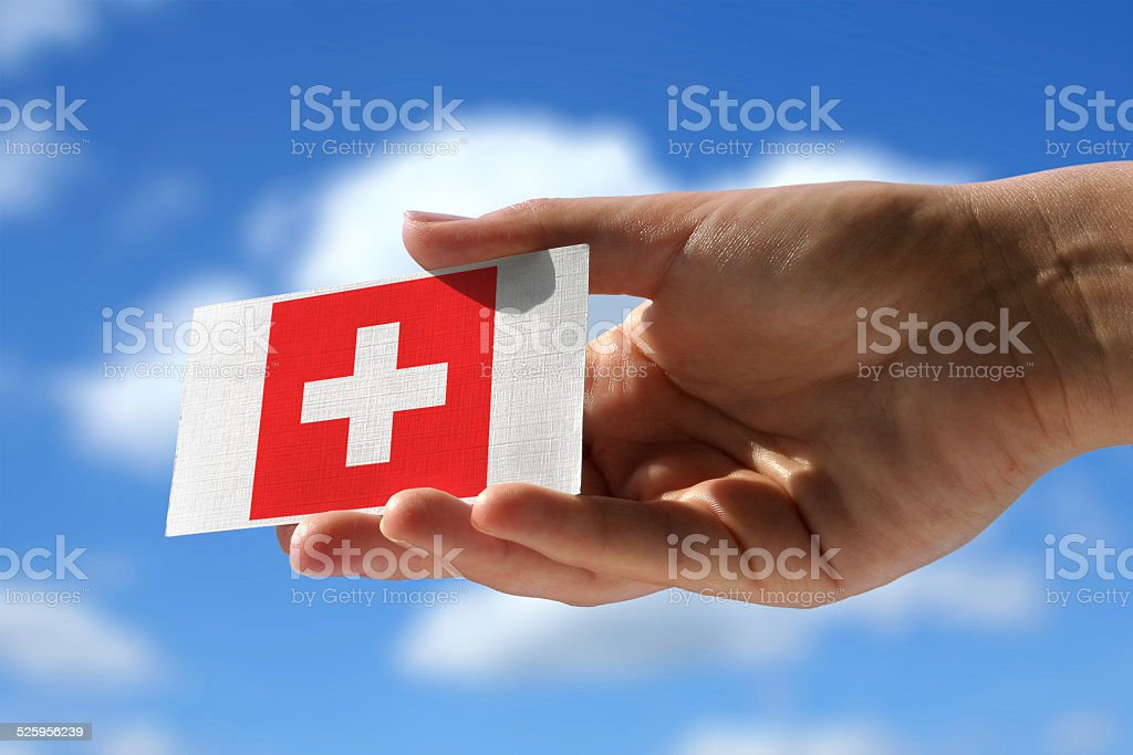 National flag of Switzerland over visiting card stock photo