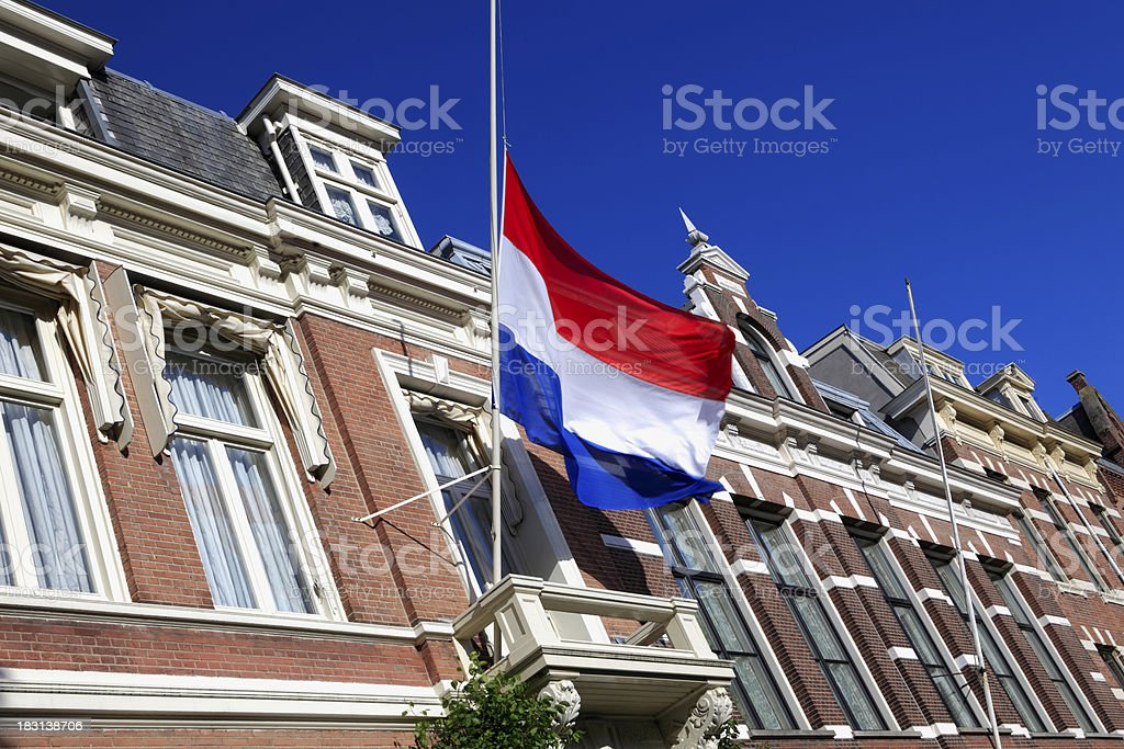 national flag of the Netherlands at half-mast stock photo