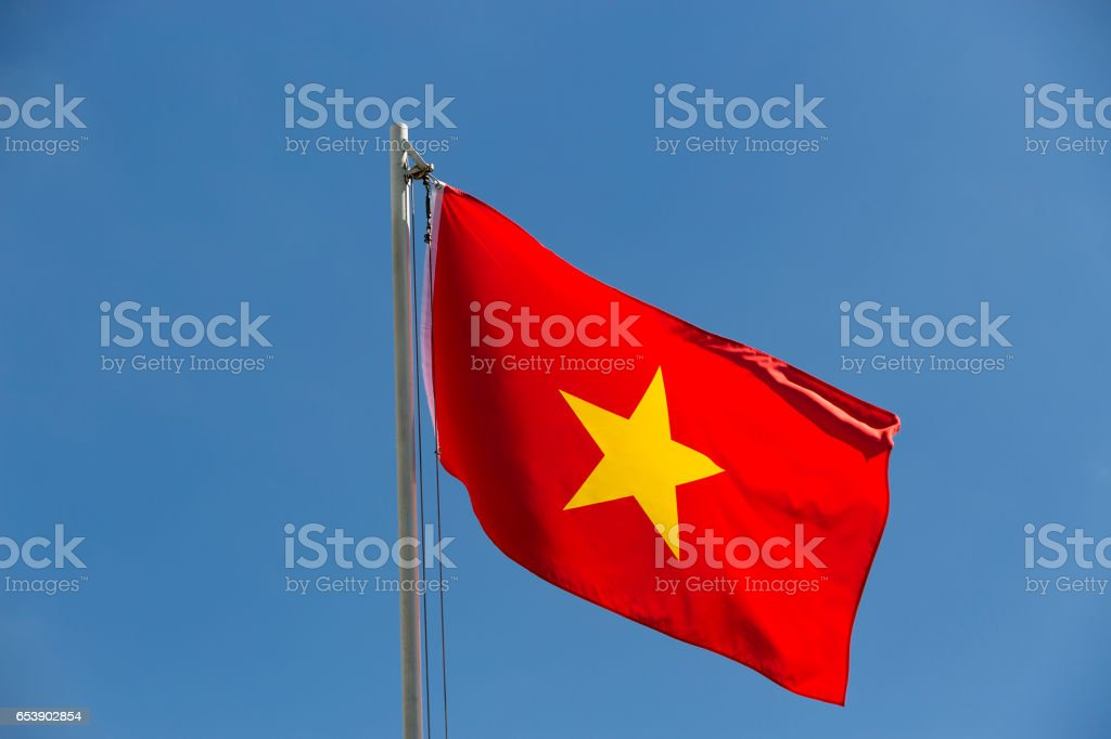 National flag of Vietnam on a flagpole stock photo
