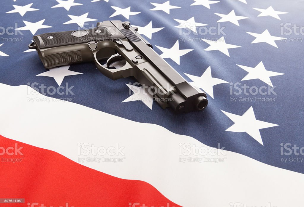 National flag with hand gun over it series - USA stock photo