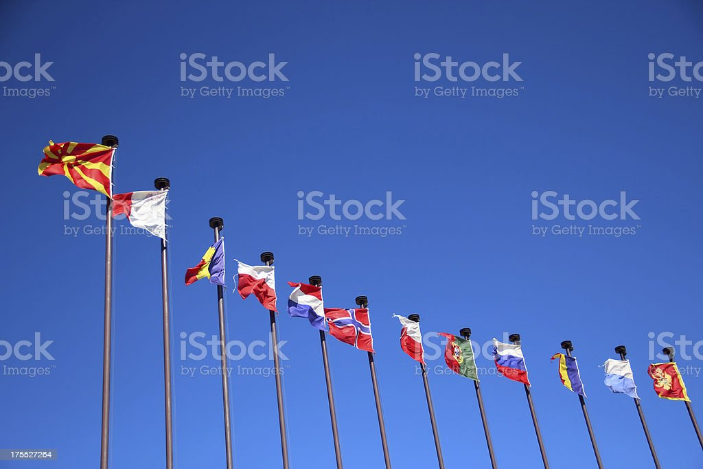 national flags on a blue sky background stock photo