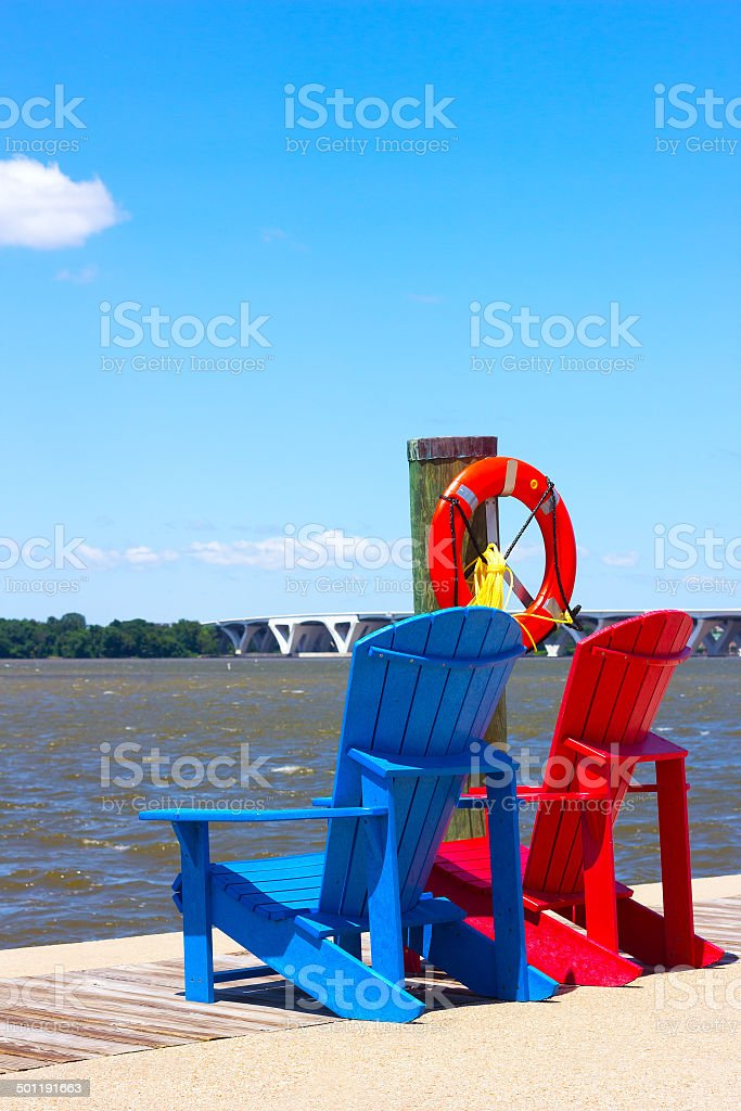 National Harbor pier with colorful chairs. stock photo