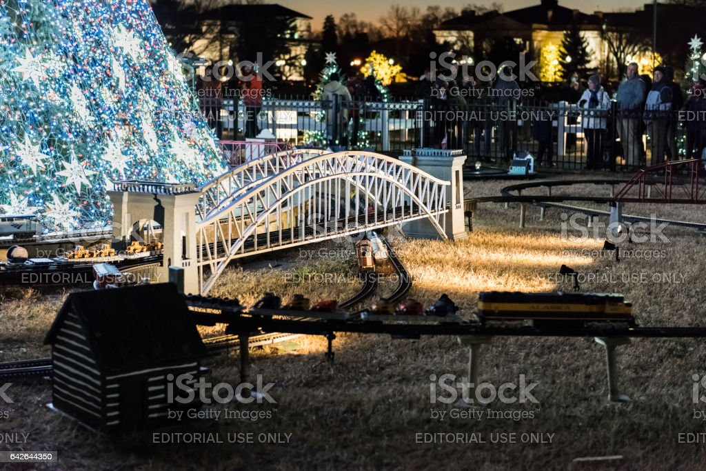 National Mall Christmas tree with visitors illuminated with toy trains stock photo