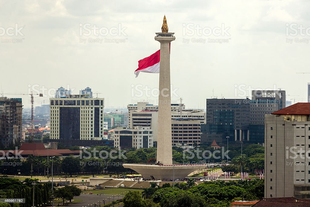National Monument of Indonesia with flag stock photo