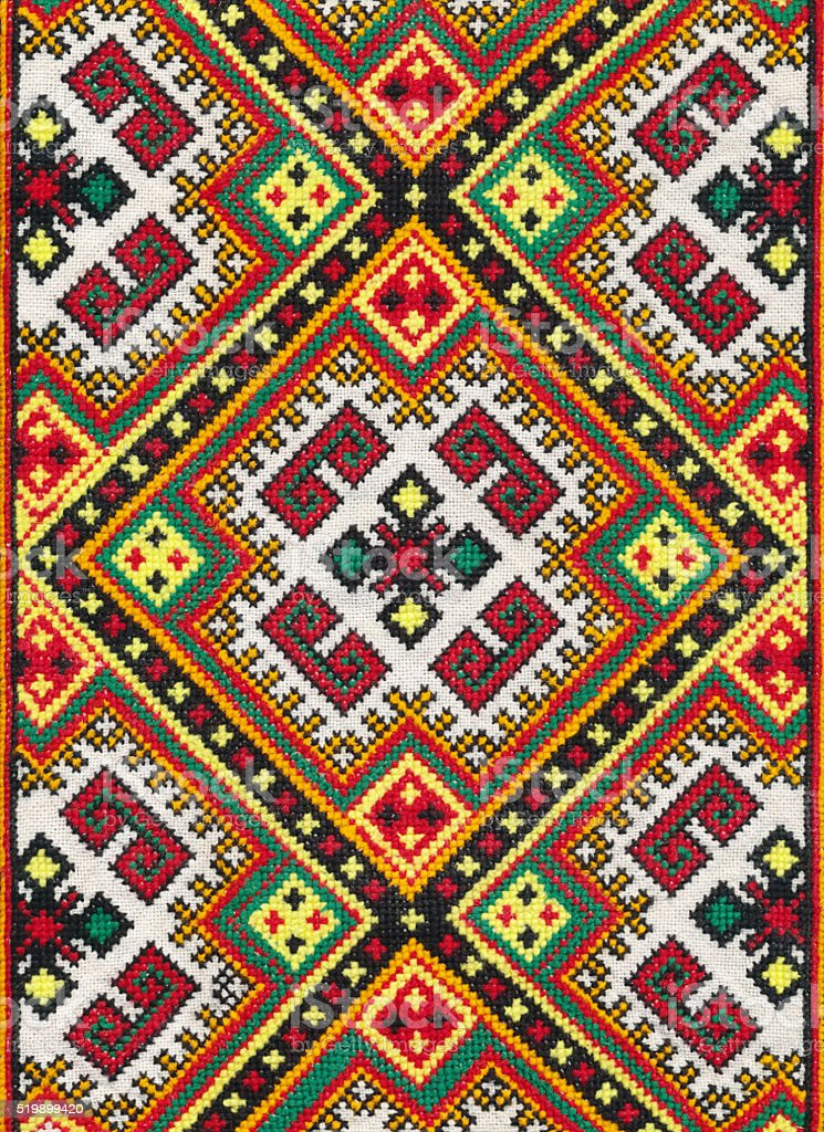 national ornament on textile, photo of ethnic decoration, handmade needlework stock photo