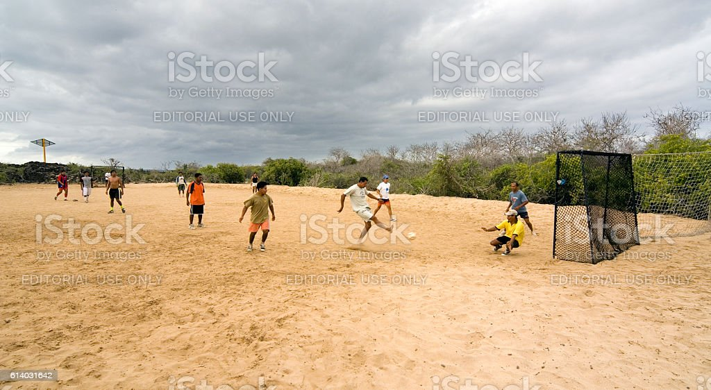 National park tour guides playing football, Galapagos islands stock photo
