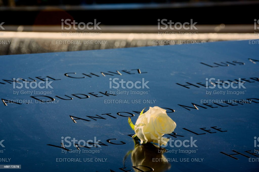 National September 11 Memorial Inscriptions and Flower, Ground Zero, NYC stock photo