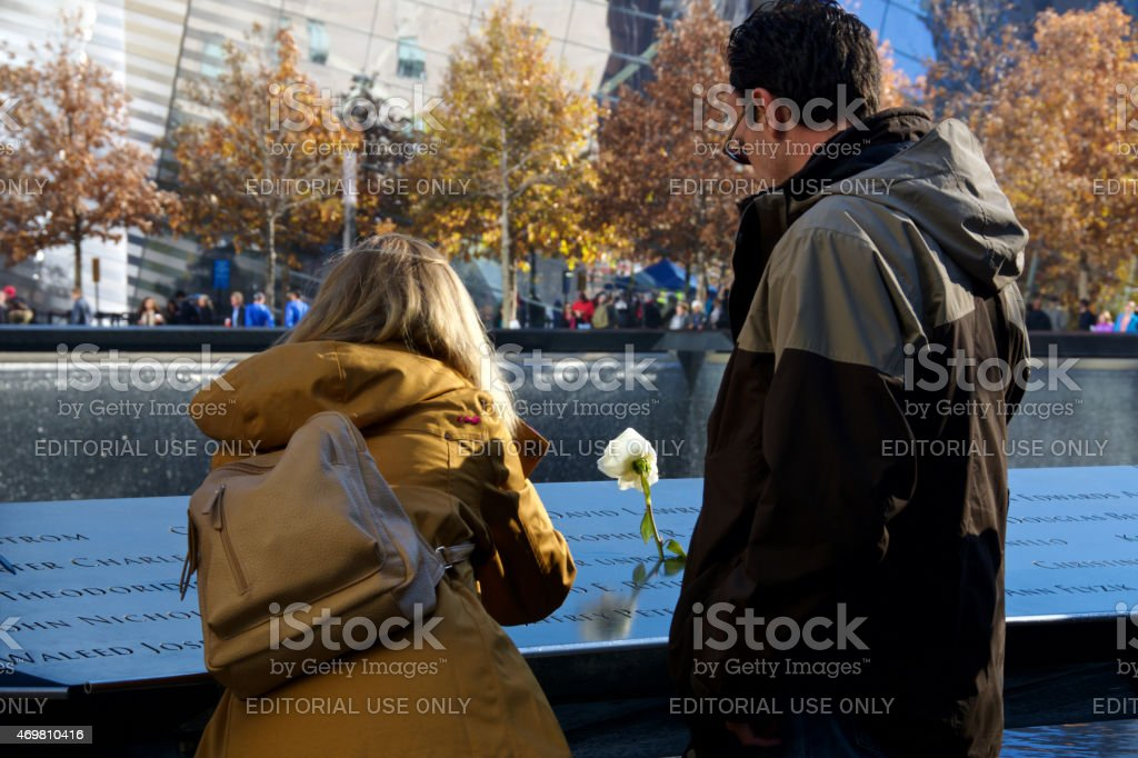 National September 11th Memorial Inscriptions, Visitors and Yellow Roses, NYC stock photo