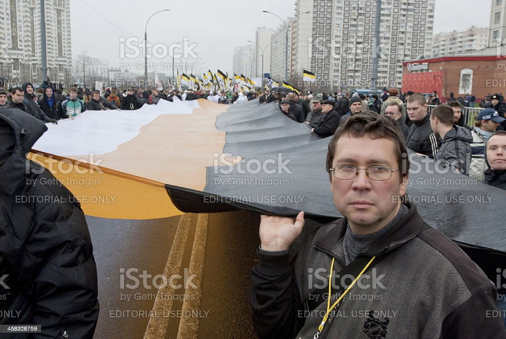Nationalist holds a simbolic flag during 'Russian March', Moscow, Russia stock photo