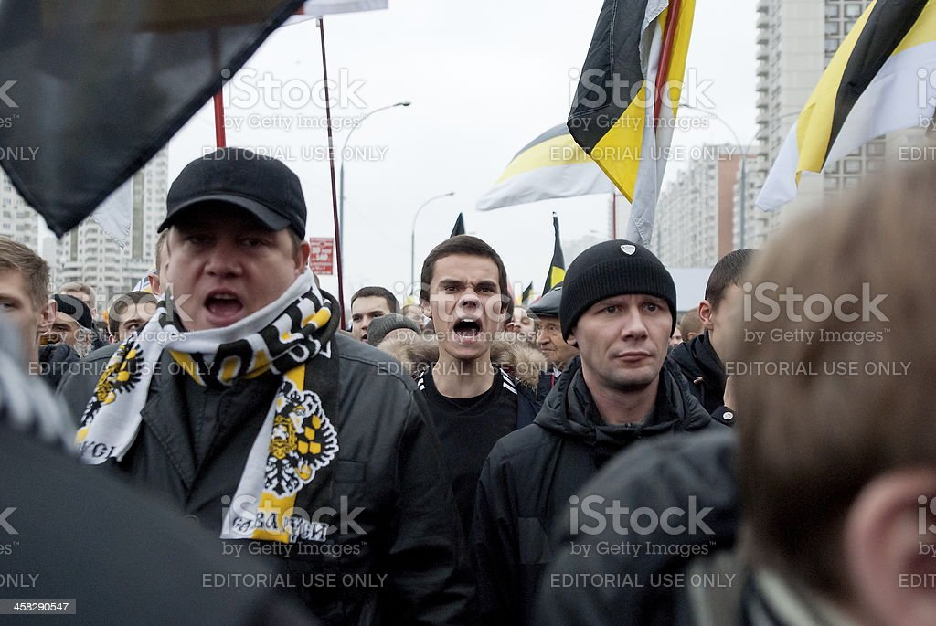 Nationalists shout anti-muslim slogans during 'Russian March' in Moscow, Russia. stock photo