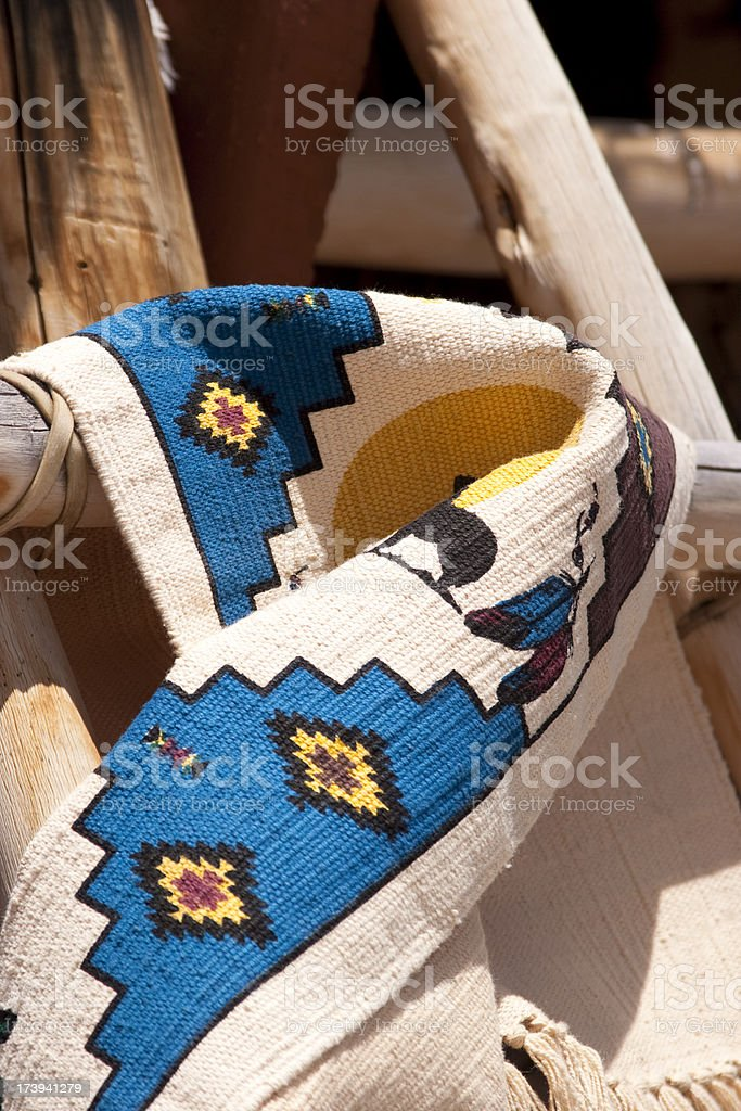 Native American Blanket Folded on Wooden Ladder, Outdoor, Sunshine stock photo
