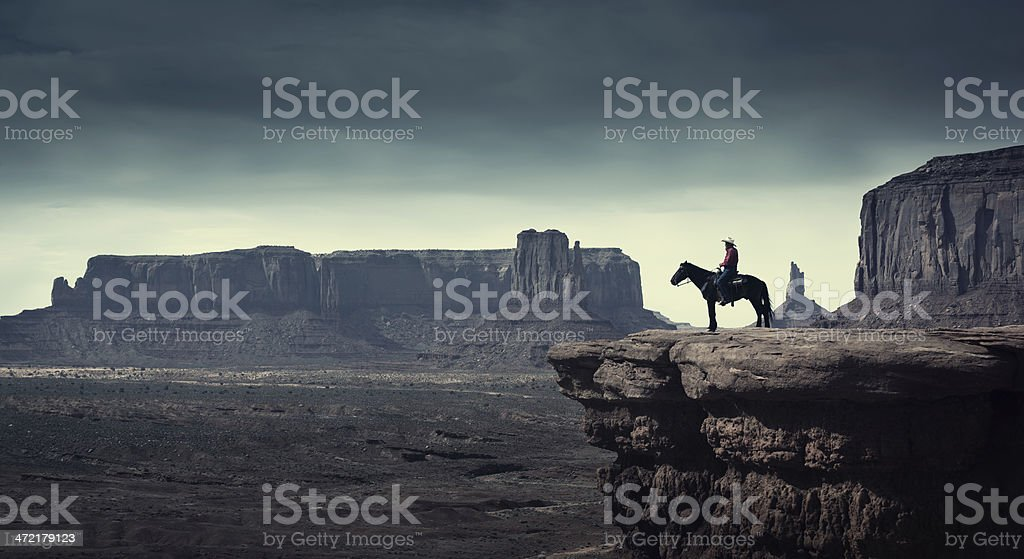 Native American Cowboy on Horse at Monument Valley Tribal Park stock photo
