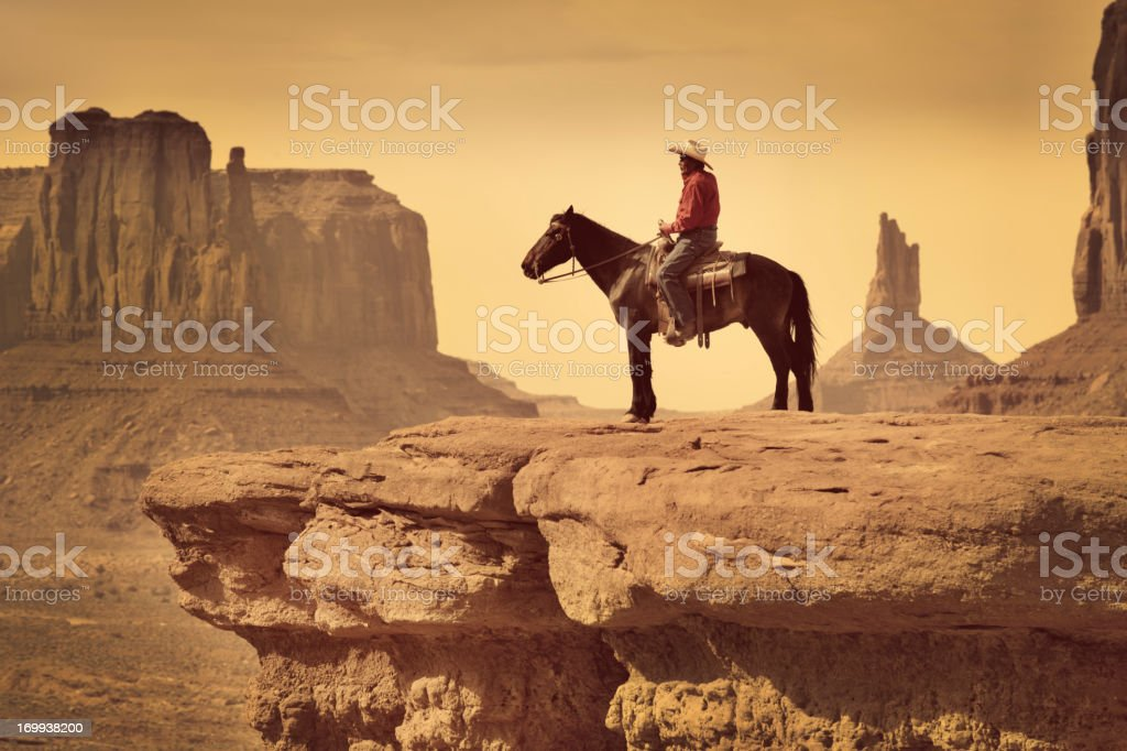 Native American Indian Cowboy on Horse in the Southwest Landscape stock photo