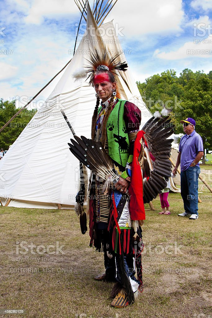 Native American Indian warrior in front of Tipi stock photo