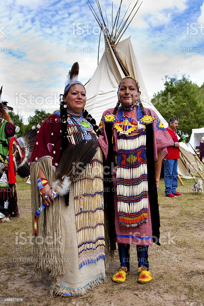 Native American Indian woman in front of Tipi stock photo
