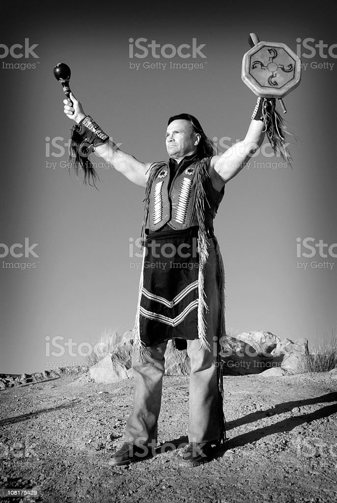 Native American Man Holding Drum in Air royalty-free stock photo