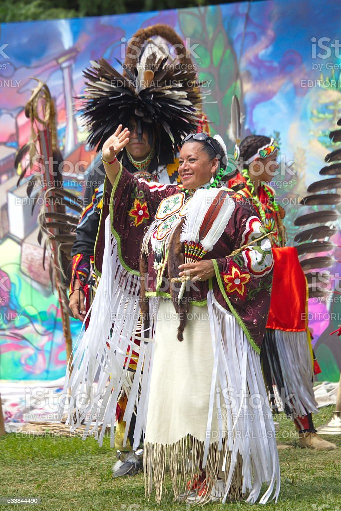 Native American performers dancing at a pow-wow stock photo