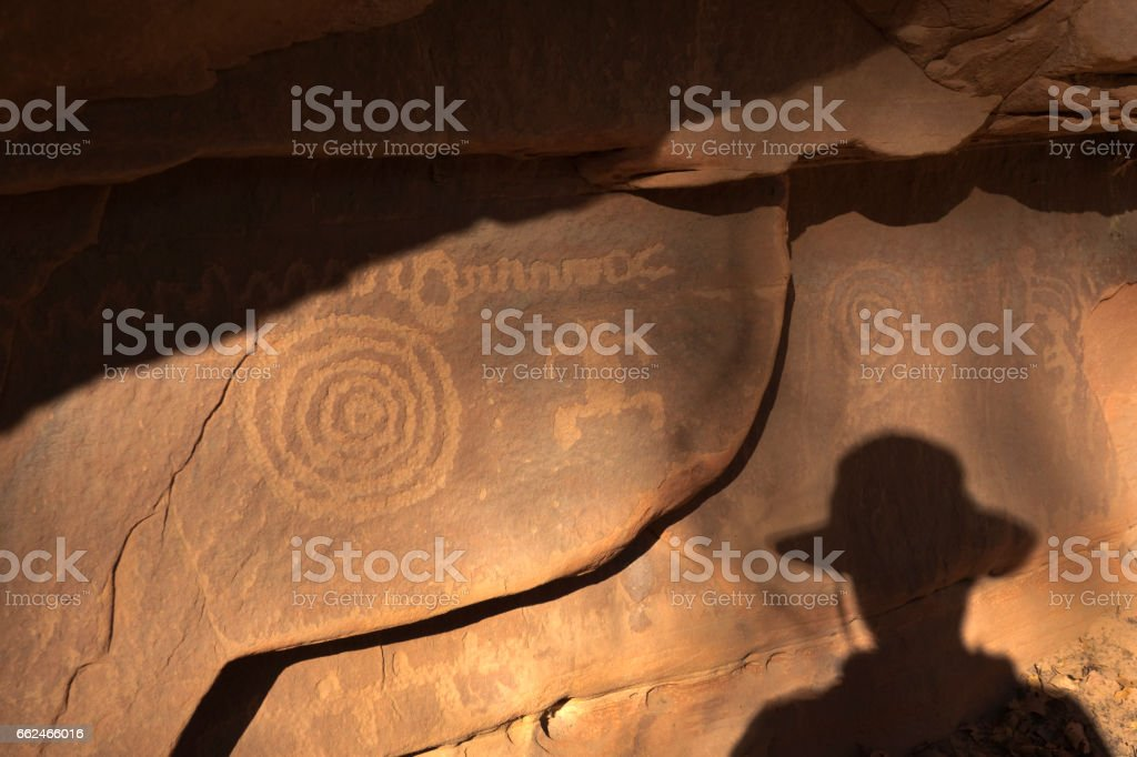 Native American petroglyph cliff Zion National Park Utah cowboy shadow stock photo
