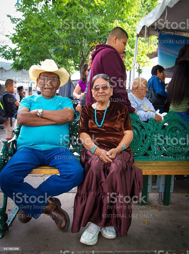 Native American Seniors on Bench; 2015 Santa Fe Indian Market stock photo