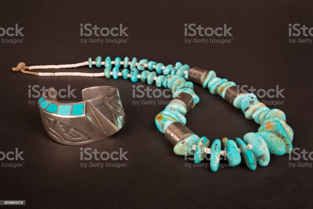 Native American Silver Cuff Bracelet and Large Turquoise Nugget Necklace. stock photo
