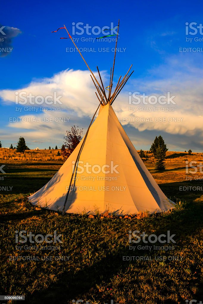 Native American Tepee on the Montana plains at sunset stock photo
