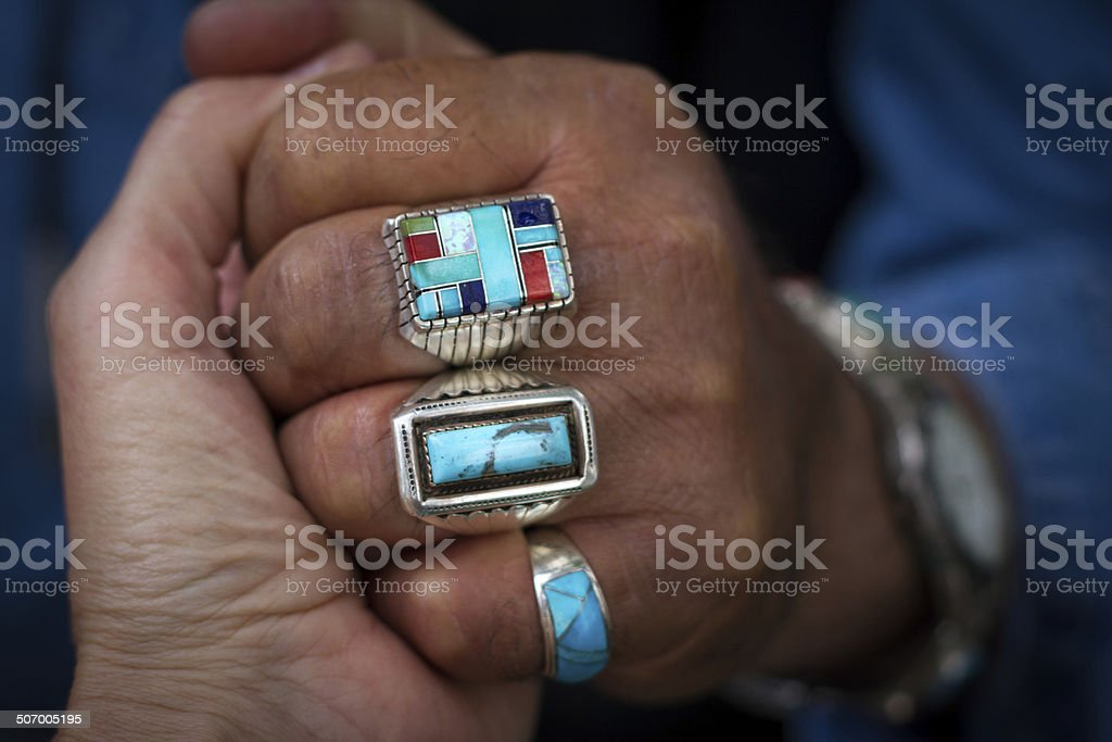 Native American Turquoise Rings On Man's Hand (Close-Up) stock photo