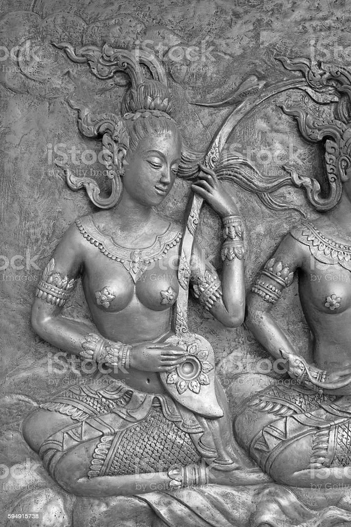 Native culture Thai sculpture on the temple wall, stock photo
